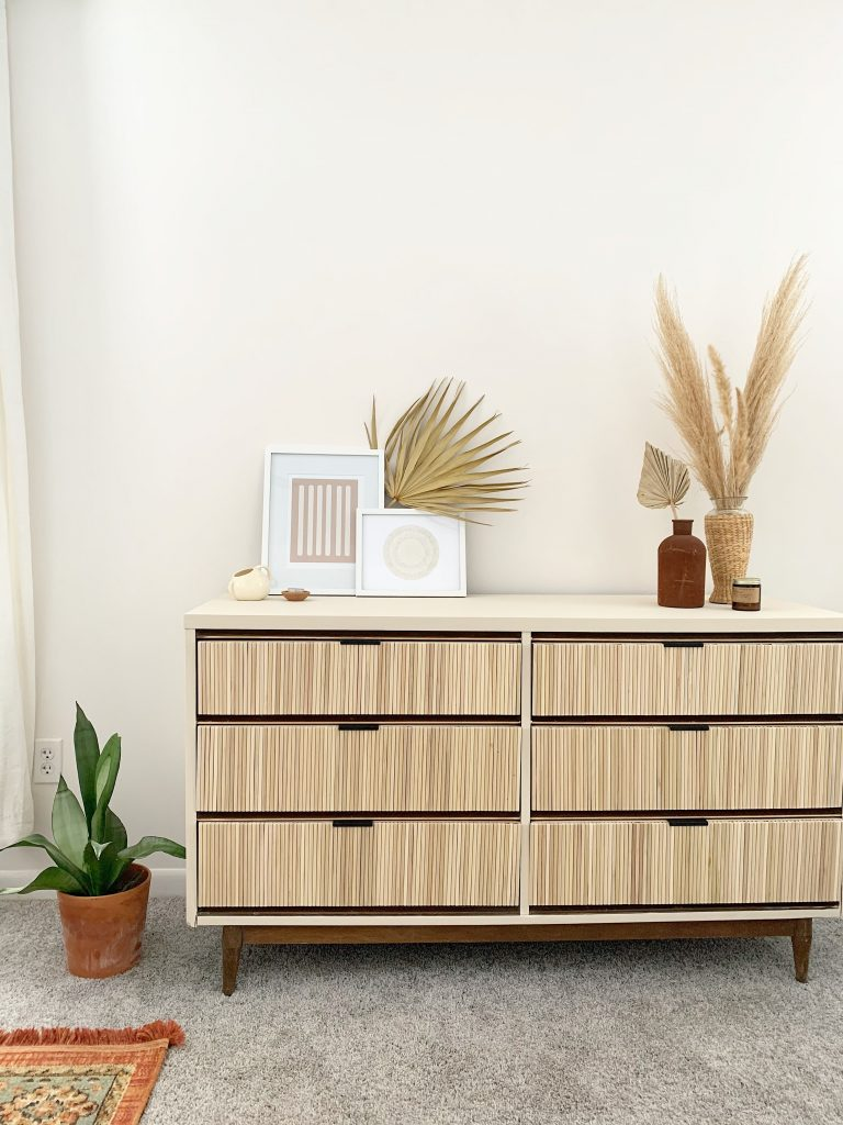 fluted dresser placed in front of a white wall