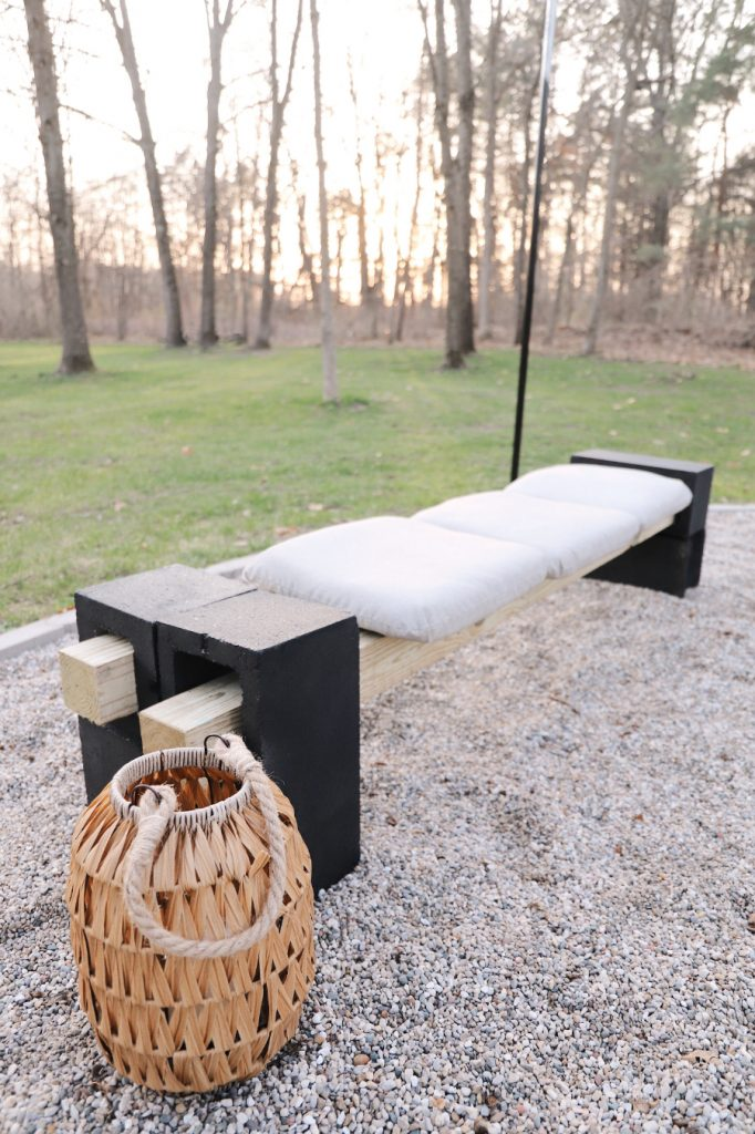 bench with black cinder blocks on a patio